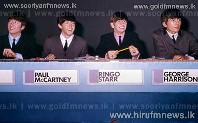 Unpublished early color photographs of The Beatles to be auctioned.
