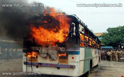 Bus carrying Sri Lankan pilgrims caught ablaze; passengers unscathed.