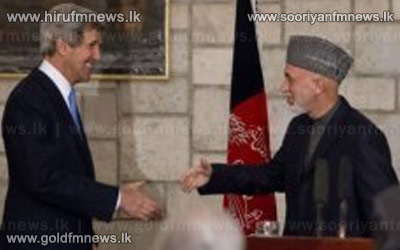 Kerry+backs+Afghanistan+as+Karzai+hails+prison+deal+++