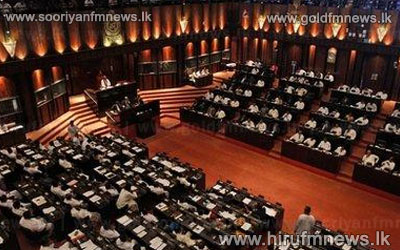 Opposition+lights+candle+sticks+in+Parliament%3B+Water+bottles+from+Government%3B+JVP+on+top+of+tables
