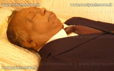 The+remains+of+Dr.Jayalath+Jayawardana+taken+to+his+home+in+Weligampitiya