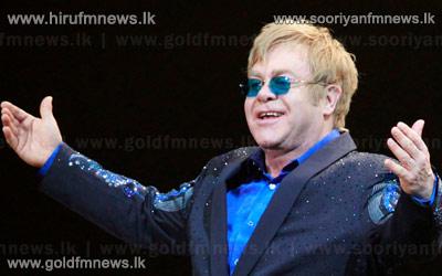 Elton+John+postpones+his+upcoming+summer+tour.