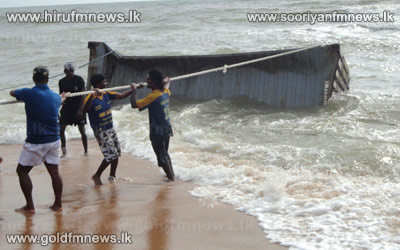 A+container+emerges+from+Chilaw+Sea.