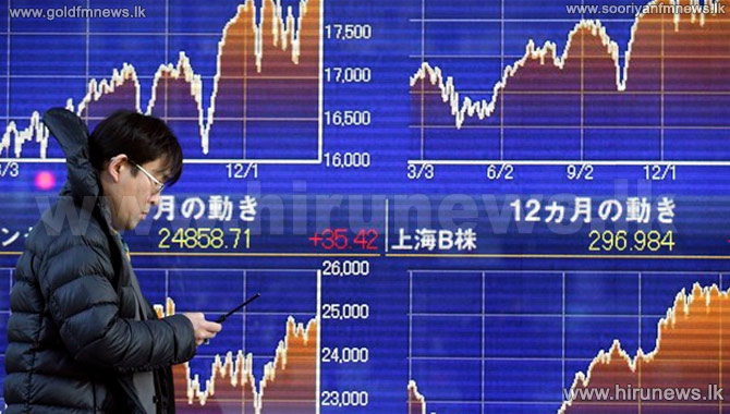 Asia+shares+in+mixed+trading+despite+US+market+falls