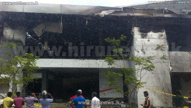 Shops+destroyed+in+a+fire+in+Kandy+