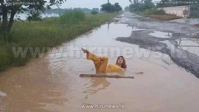 Thai+women+take+dip+in+the+road+in+pothole+protest