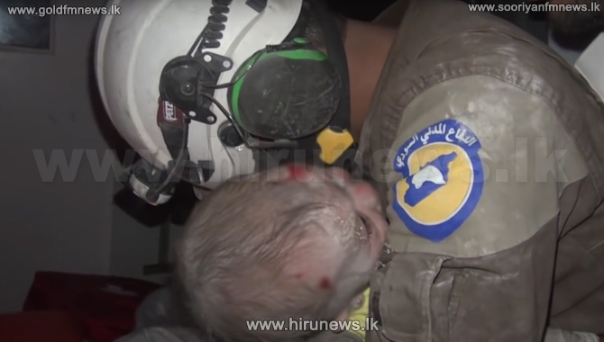 Rescue+Worker+Cries+as+He+Pulls+Baby+Alive+From+Rubble+in+Syria
