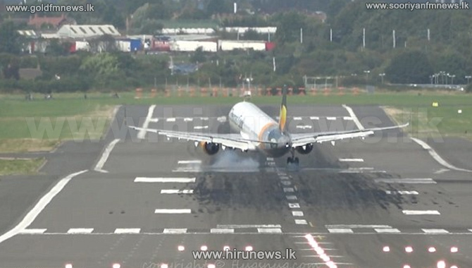 Thomas+Cook+Airbus+A321+makes+a+hairy+landing+in+a+strong+crosswind+at+Birmingham+Airport