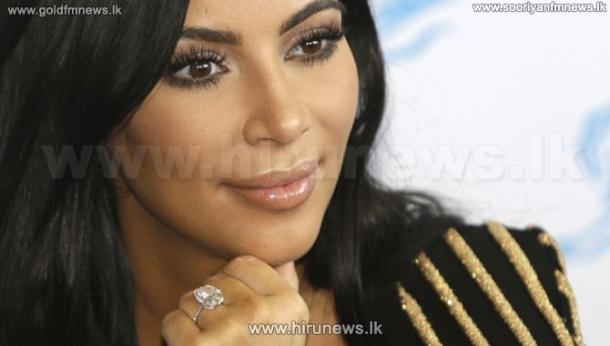 Kim+Kardashian+West+sues+over+claims+she+faked+robbery