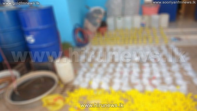 Police+raids+an+illicit+liquor+brewery+in+Badulla+