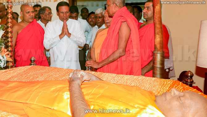 President+pays+respect+to+late+Thera