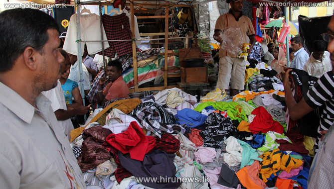 A+racket+where+old+clothes+were+renewed+and+sold+discovered+from+Pettah