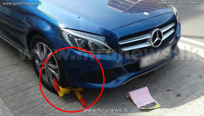 Vehicle+tires+sealed+for+not+paying+parking+fees+in+Colombo