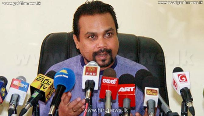 Wimal+questions+how+one+hundred+thousand+US+dollars+credited+to+a+bank+account+of+Rishard+in+the+US
