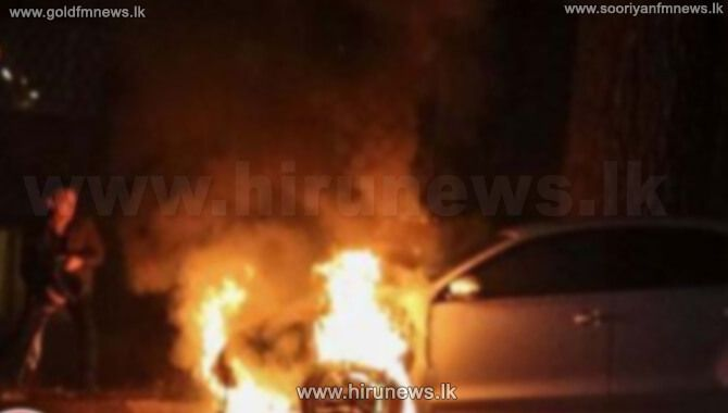 A+MOTOR+VEHICLE+PARKED+OPPOSITE+A+HOUSE+IN+MANIPAY+SET+ON+FIRE
