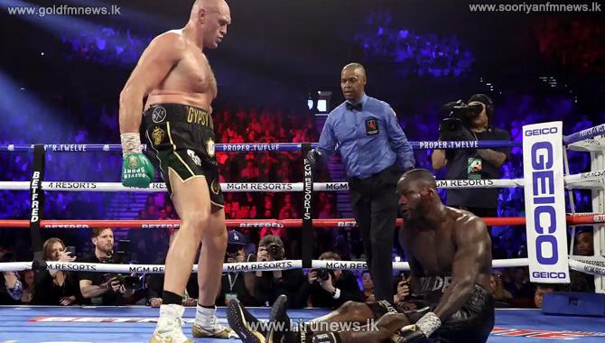 Tyson+Fury+beats+Deontay+Wilder+by+TKO+to+win+WBC+heavyweight+world+championship