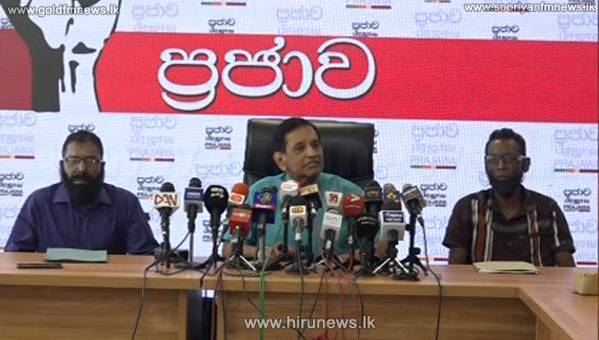 Ten+people+arrested+with+a+T+56%2C+including+the+two+suspects%2C+who+appeared+at+the+white+van+press+conference+with+Rajitha+