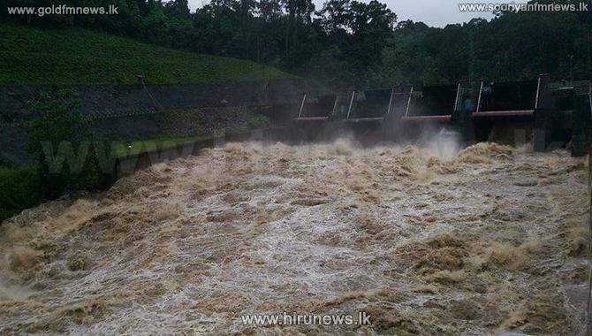 Two+sluice+gates+of+the+Kukuleganga+Reservoir+opened