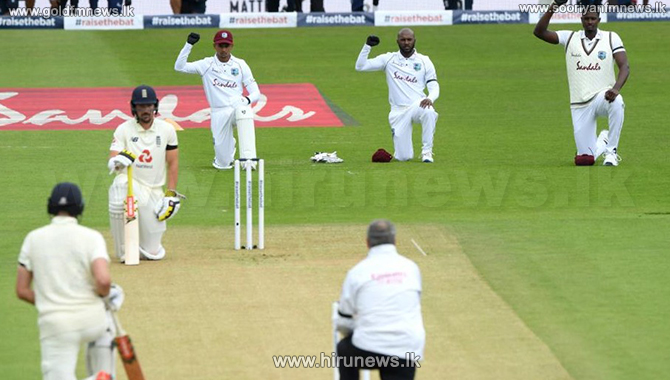 England & West Indies players take a knee