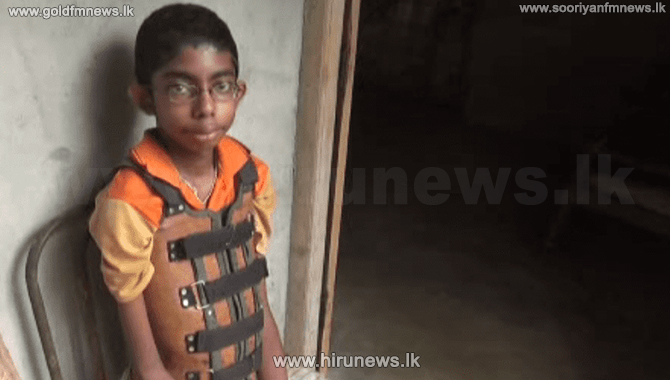 Schoolboy suffering from muscular dystrophy (video)