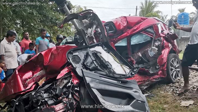 Hotel worker killed after luxury car collides with train (PHOTOS)