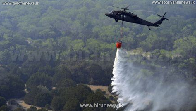 Air Force assists in extinguishing fire at Ravana Ella Reserve (Video)