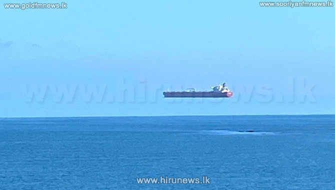 'Hovering ship' photographed in rare optical illusion