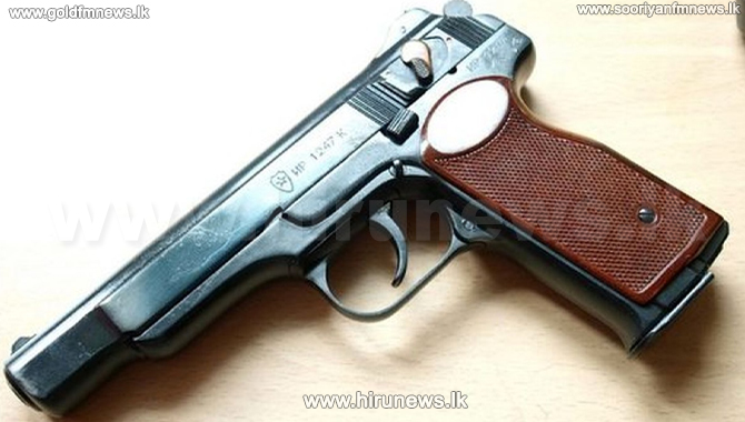 Two arrested with a foreign pistol