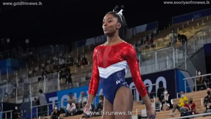 US champion Simone Biles withdraws from the individual all-around competition