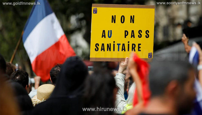 French police clash with anti-virus pass protesters in Paris