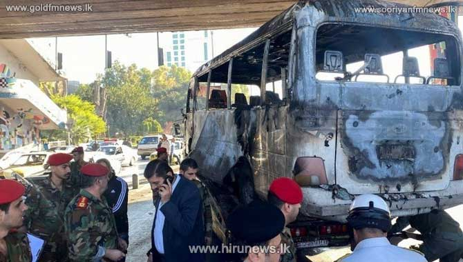 Syria war: Deadly bomb blasts hit military bus in Damascus
